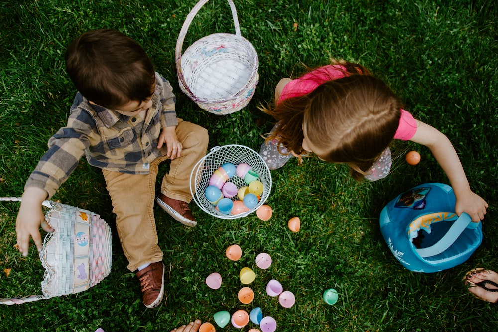 https://unsplash.com/@gaberce picture  Children playing with easter egss